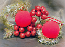 Red New Year's ball, decorative berries and tinsel.Christmas still life Stock Photos