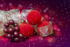 Red New Year's balls and ribbon Stock Photo