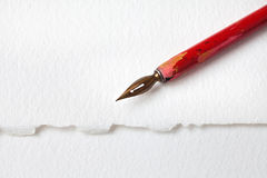 Red nib fountain pen on white paper textured background. macro view shallow depth of field, copy space Royalty Free Stock Images