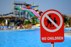 Red no children warning sign at the poolside Royalty Free Stock Photo