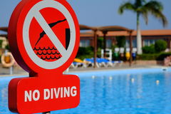 Red no diving warning sign at the poolside Royalty Free Stock Image