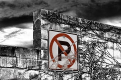 Red No Parking Sign on Black and White Wall Royalty Free Stock Photo