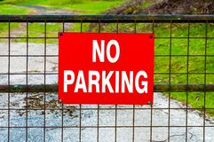 Red NO PARKING sign Stock Image