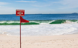 Red No Swimming Prohibited Sign on the beach in Rio de Janeiro Stock Photo