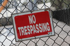 Red No Trespassing Sign On Fence Stock Photography