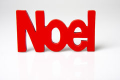 Red Noel. Photo of a 3d wood Noel colored red on a white background Stock Photo