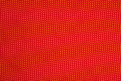 Red nonwoven fabric on a yellow Royalty Free Stock Images