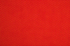 Red nonwoven fabric on a yellow Stock Photography