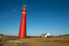 The red North Tower lighthouse on the Dutch island Schiermonnikoog. The Netherlands stock photo