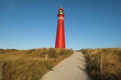 The red North Tower lighthouse on the Dutch island Schiermonnikoog. The Netherlands royalty free stock image