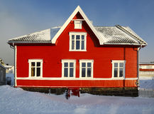 Red norwegian house. External face of a red house in northern Norway stock image