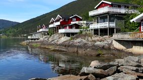 Red norwegian houses. Red fisherman houses at the fjord coast, Norway stock video