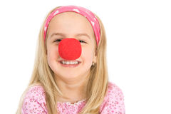 Red nose. Little blond girl laughing with a red nose Royalty Free Stock Photography