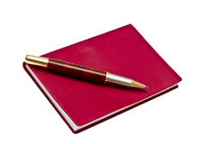 Red note book and pen Royalty Free Stock Photo