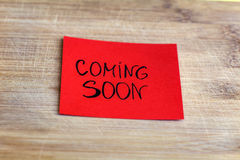 Red Note paper with coming soon message Stock Photo
