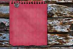 Red note on rustic background Stock Image