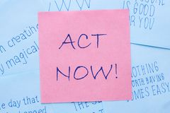 Act Now Concept. Red note with text written ACT NOW on blue background. Business concept stock photo