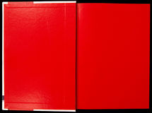 Red notebook. On black background stock image