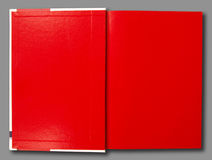 Red notebook. On gray background royalty free stock photo