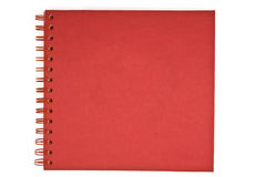 Red notebook. Red spiral notebook isolated on white Royalty Free Stock Image