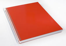 Red notebook. Isolated on white. Shallow DOF Royalty Free Stock Photos