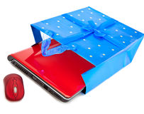 Red notebook and a computer mouse are packed Stock Photos