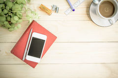 Red notebook diary on wooden table with coffee, Vintage Style Royalty Free Stock Images