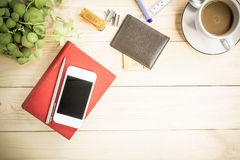 Red notebook diary on wooden table with coffee, Vintage Style. Royalty Free Stock Images