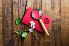 Red notebook and magnifier royalty free stock image