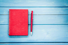 Red notebook with pen Royalty Free Stock Images
