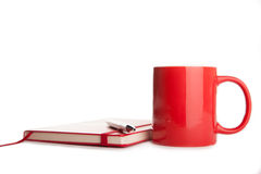 red notebook, pen and cup of tea isolated Stock Photo