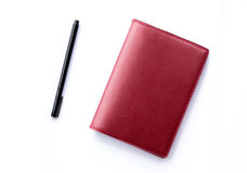 Red notebook with pen isolated Royalty Free Stock Photography