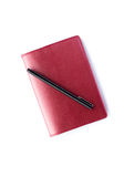 Red notebook with pen isolated Stock Photos