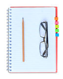 Red notebook pencil and eyeglasses  on white background Royalty Free Stock Photo