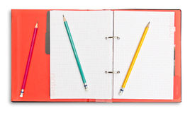 Red notebook and pencil isolated Royalty Free Stock Images