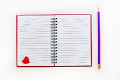 Red notebook and pencil Stock Image