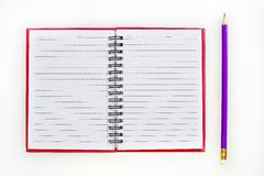 Red notebook and pencil Stock Photos