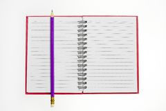 Red notebook and pencil Royalty Free Stock Photo