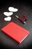 Red notebook with romantic diary Stock Photography