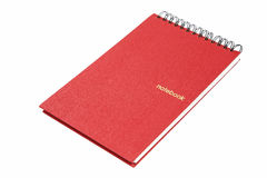 Red notebook with spiral bound Stock Photo