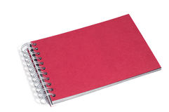 Red notebook  on white. Background Royalty Free Stock Images