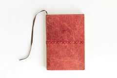 Red notebook on white background Royalty Free Stock Photo