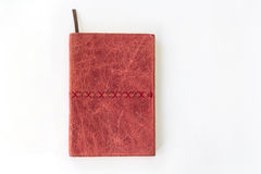 Red notebook on white background Stock Images