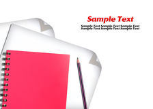 Red notebook and white paper with pencils Stock Image