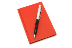 Red notepad with ball pen Royalty Free Stock Image