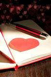 Red notepad for love message Stock Photography