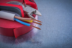 Red nsulation tape cutting pliers electric wires construction co Royalty Free Stock Photos