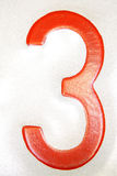 Red number 3. Bright red number three on white background Royalty Free Stock Image