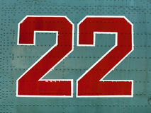 Red 22 numbers on aircraft fuselage close up. Stock Photo