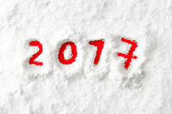 Red numbers 2017 on the snow Royalty Free Stock Photos